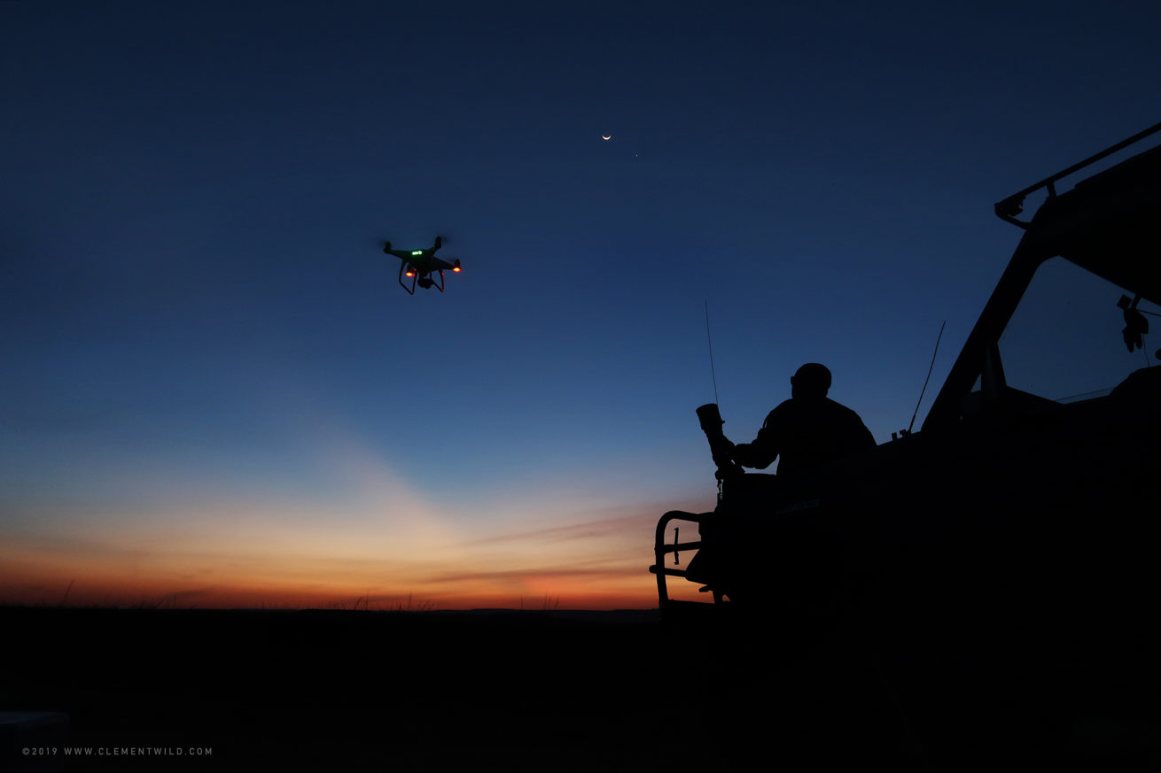 Silhouette of ClementWild at sunset with a drone and the new moon
